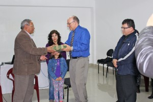 Michael Brown receiving a gift of appreciation from the Methodist Bishop of Peru, Most Reverend Samuel Aguilar.