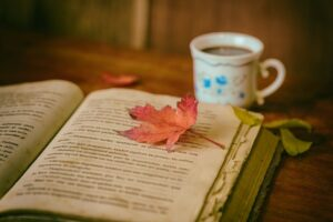 Book with coffee cup and leaf.