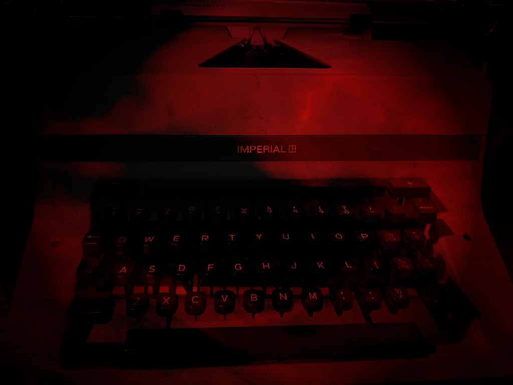 Red faded typewriter