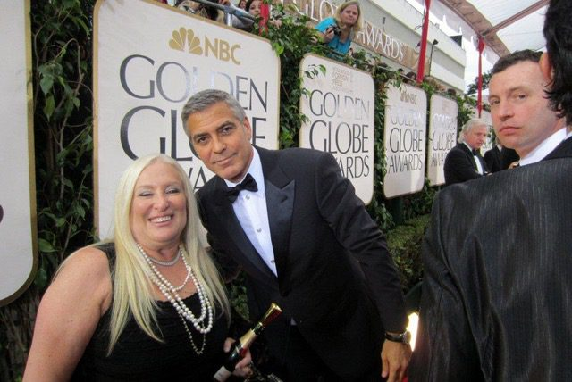 The Brave Files Podcast guest, Linda Smith, poses with George Clooney.