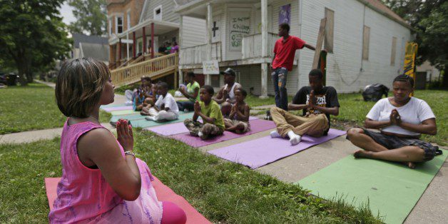 Yoga in front of The Peace House. Growing Peace. The Brave Files Podcast.