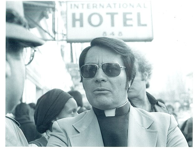 Rev. Jim Jones, 1977 at an anti-eviction rally in front of the International Hotel, Kearny and Jackson Streets, San Francisco Photo by Nancy Wong