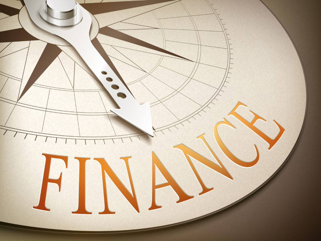 3d illustration compass with needle pointing the word finance