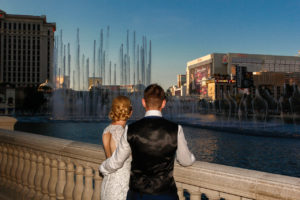 Photographers of Las Vegas - Wedding Photography - wedding bride and groom in front of Bellagio fountains