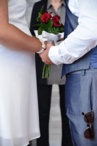 Photographers of Las Vegas - Wedding photography - holding hands and wedding flowers