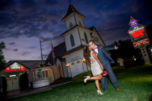 Photographers of Las Vegas - Wedding Photography - wedding couple celebration pose at twilight