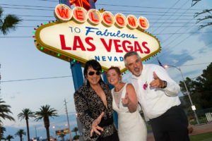 Photographers of Las Vegas - Wedding Photography - wedding couple at Vegas sign with Elvis impersonator