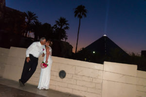 Photographers of Las Vegas - Vegas Strip Tour Photography - couple kiss Luxor pyramid background