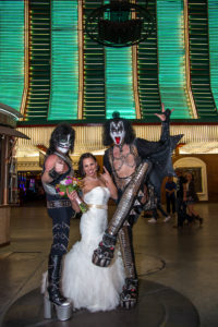 Photographers of Las Vegas - Wedding Photography - wedding bride with rock and roll kiss impersonators