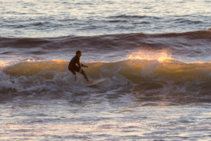 Photographers of Las Vegas - Sports Photography - California surfer on wave at sunset