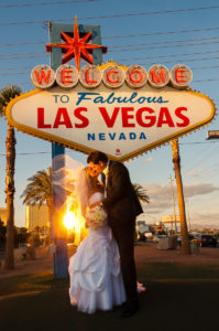 Photographers of Las Vegas - Wedding Photography - wedding couple in front of Vegas sign