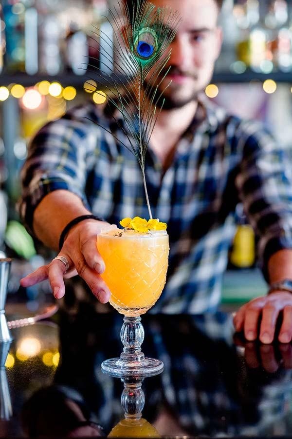 Adam Bozsoki - bartender at Rock n Rose, making drink for Cocktails in the City event