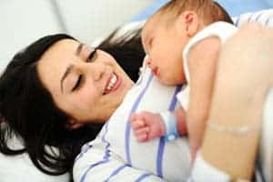 Happy-mother-with-newborn-baby-300X200