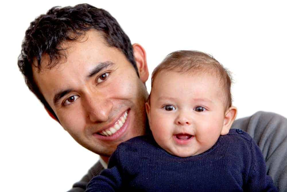 Happy man and baby boy isolated over a white background