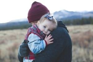 dad and baby hug