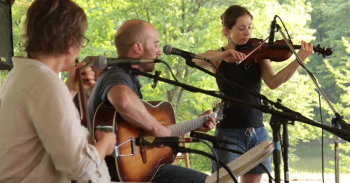 three musicians performing outdoors