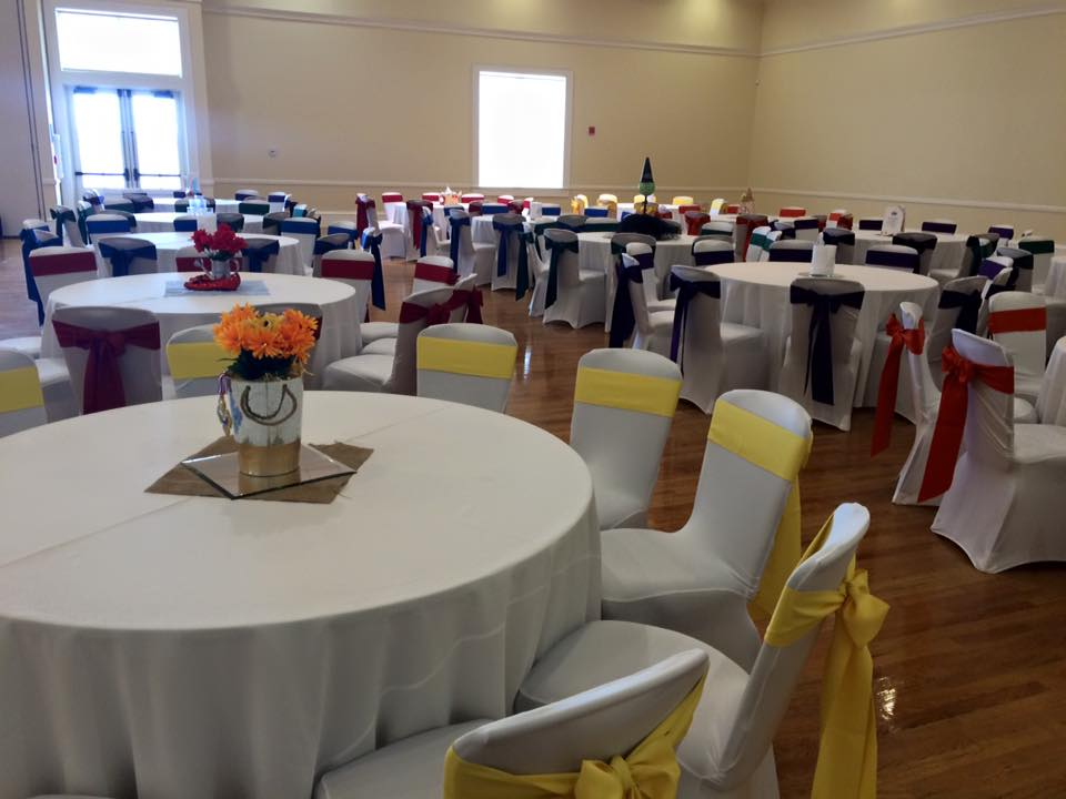 White tablecloths with variety of colored sashes at The Regent