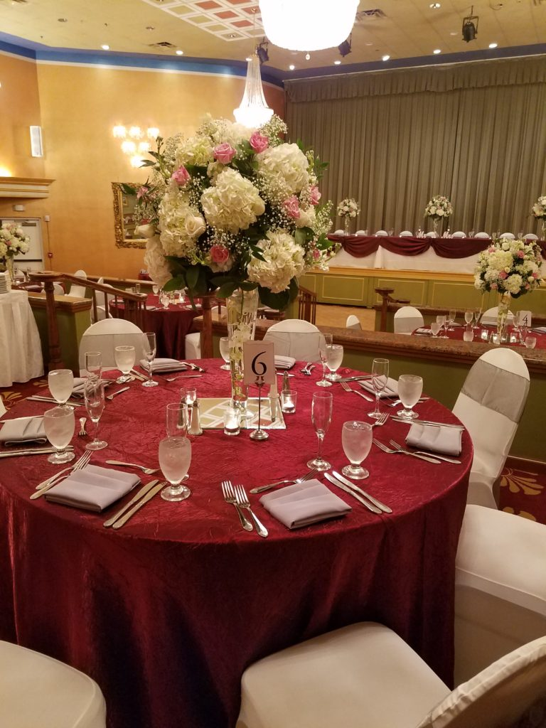 Red Crush Tablecloths w/ Silver Majestic Sashes and Napkins