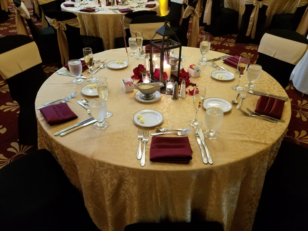 Gold Damask Tablecloths w/ Burgundy Napkins and Gold Satin Sashes
