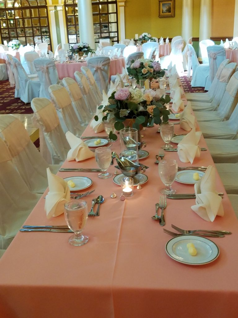 Peach Tablecloths w/ Peach Organza Sashes and Ivory Napkins