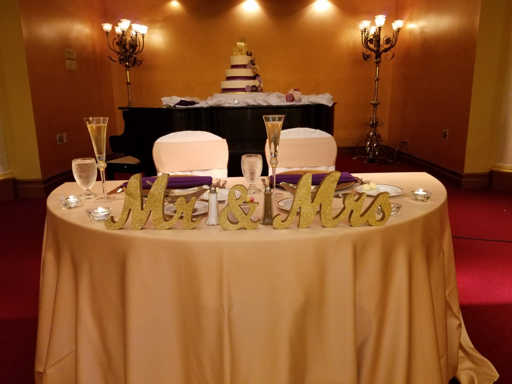 Gold Satin Tablecloth with Gold Satin Sashes and Purple Napkins