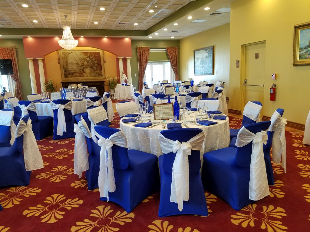 Ivory Pintuck Tablecloths and Sashes with Royal Blue Pintuck Napkins and Royal Blue Spandex Chair Coves