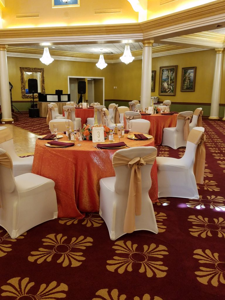 Gold Satin Sashe w/ Persimmon Crush Tablecloths and Burgundy Napkins