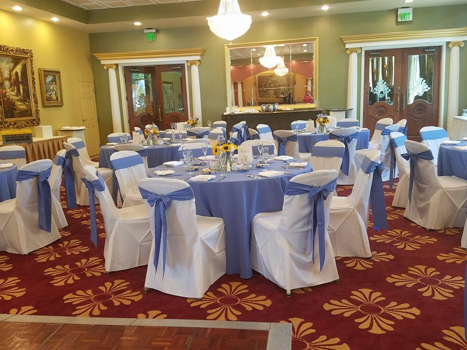 Periwinkle Tablecloths and Sashes with White Satin Napkins