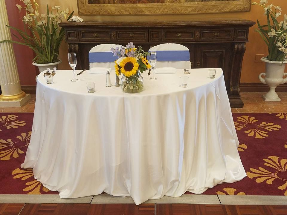 White Satin Tablecloths w/ Periwinkle Sashes and White Satin Napkins