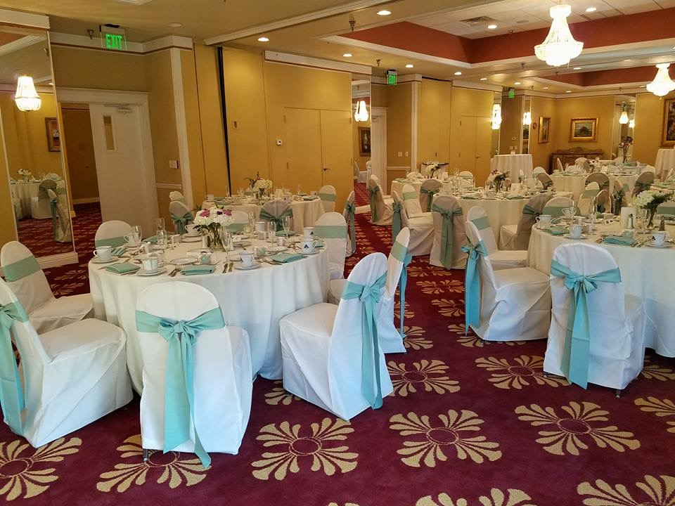 White Poly Tablecloths w/ Seamist Poly Sashes and Napkins and White Poly Chair Covers