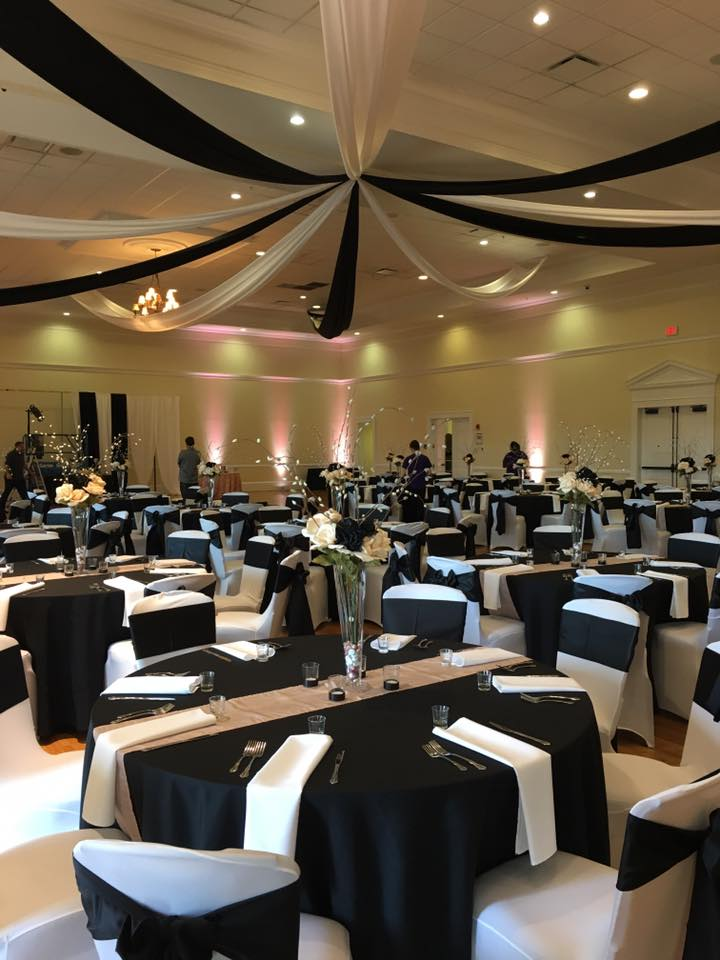 Black Poly Chair Covers w/ White Satin Napkins and Black Satin Sashes