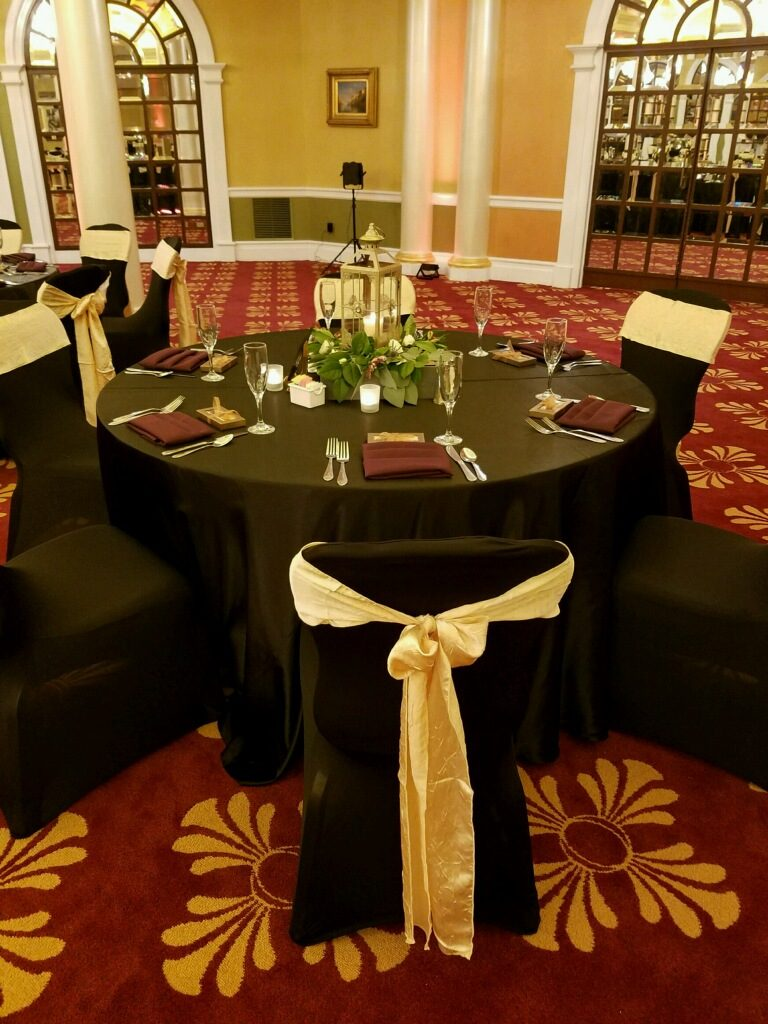 Black Tablecloths and Champagne Napkins and Sashes