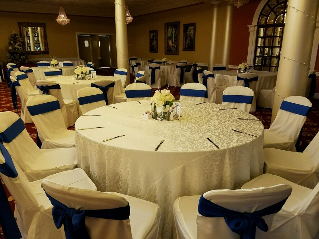 White Damask Tablecloth w/ Royal Blue Poly Sashes and  Poly Chair Covers