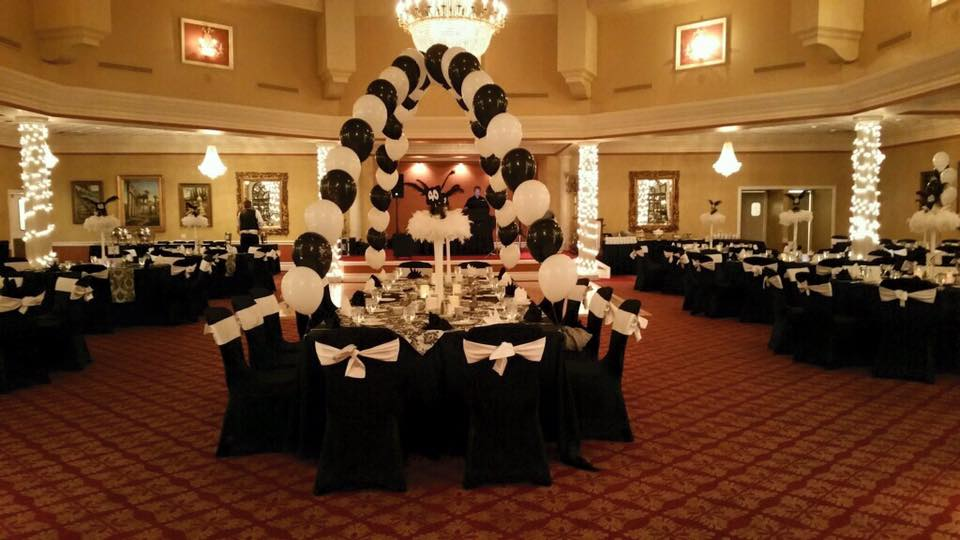 White Satin Sashes and Black Tablecloths w/ Black Spandex Chair Covers