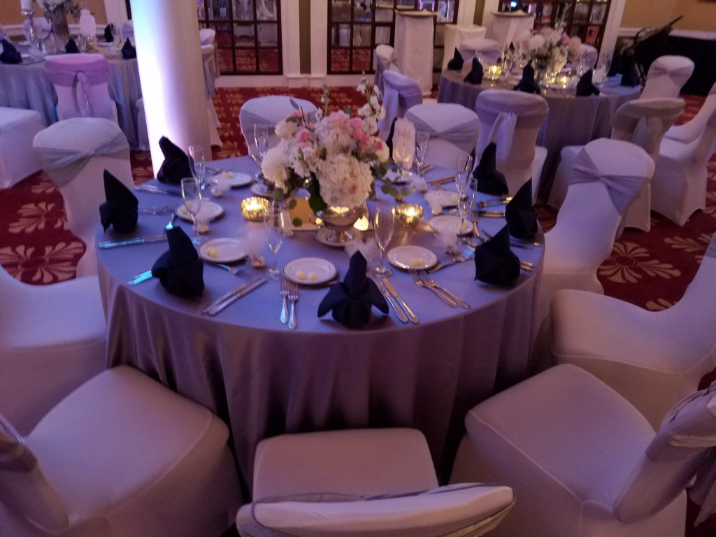 Silver Crush Sashes and Navy Blue Napkins w/ Lilac Majestic Tablecloths