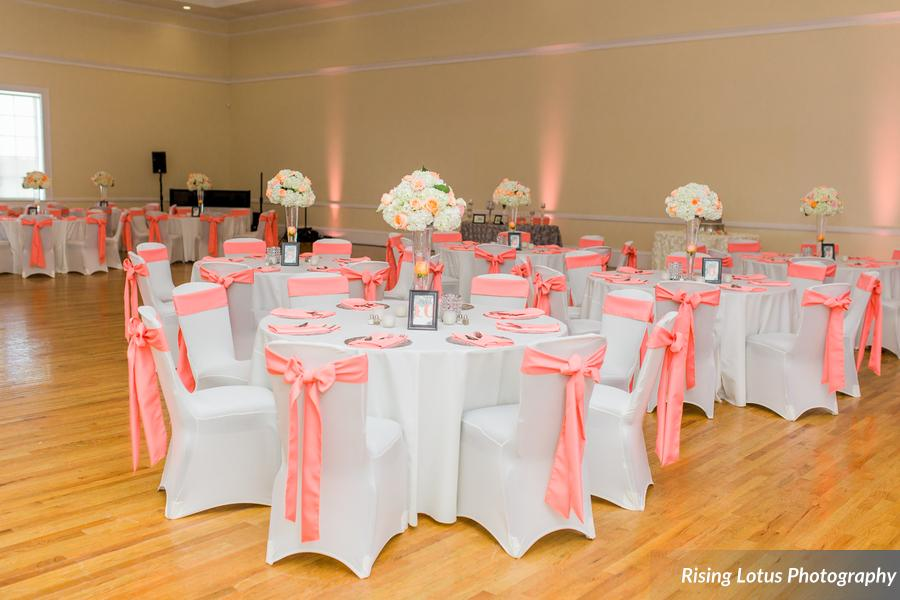White Poly Tablecloths w/ Coral Poly Sashes and Napkins and White Spandex Chair Covers