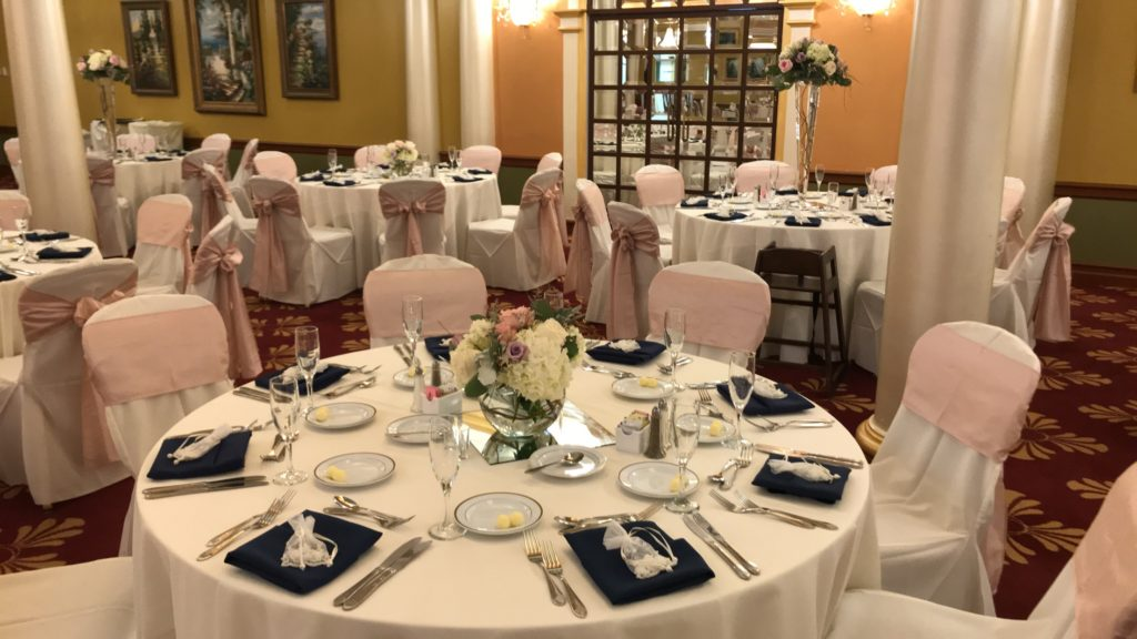 White Poly Tablecloth w/ Blush Crush Sashes , Navy Poly Napkins and White Poly Chair Covers