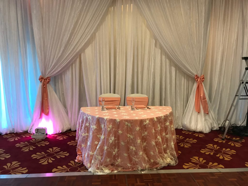 Ivory Baby Rose Overlay with Coral Majestic Tablecloth, Sashes and Napkins
