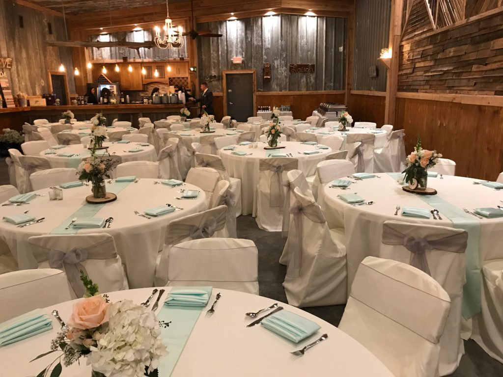 White Poly Tablecloths w/ Silver Organza Sashes and Aqua Satin Napkins and Runners and White Poly Chair Covers