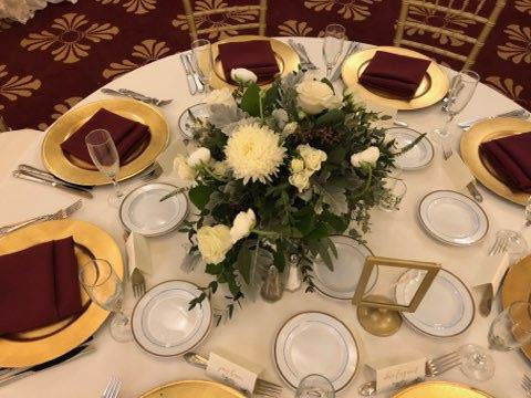 Ivory Poly Tablecloths with Burgundy Poly Napkins and Gold Chargers