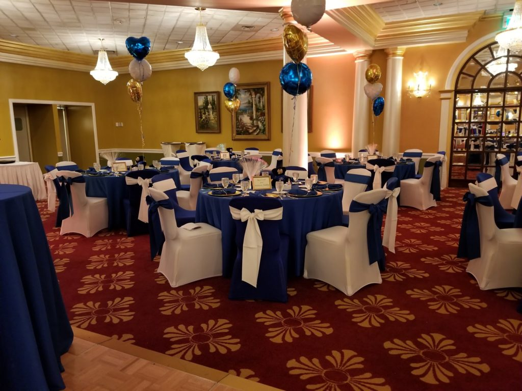 Royal Blue Poly Tablecloths and Spandex Chair Covers w/ White Poly Sashes and Chair Covers and Royal Blue Poly Napkins