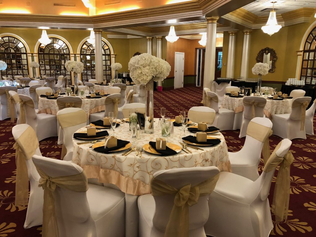 Gold Vine Overlay w/ White Poly Tablecloth, Black Poly Napkins, Gold Organza Sashes and White Spandex Chair Covers