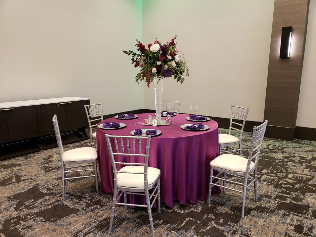 Raspberry Majestic Tablecloths with Purple Majestic Napkins, Silver Bling Wrap and Silver Chargers