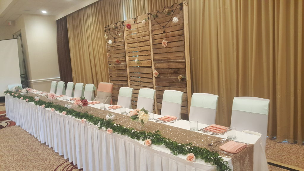 White Poly Tablecloths with Blush and Mint Satin Sashes and Blush Sequin Runner w/ White Spandex Chair Covers