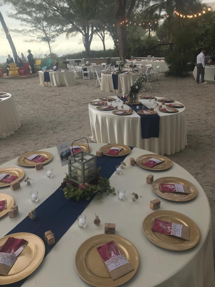 Ivory Majestic Tablecloths with Navy Poly Runners and Gold Chargers