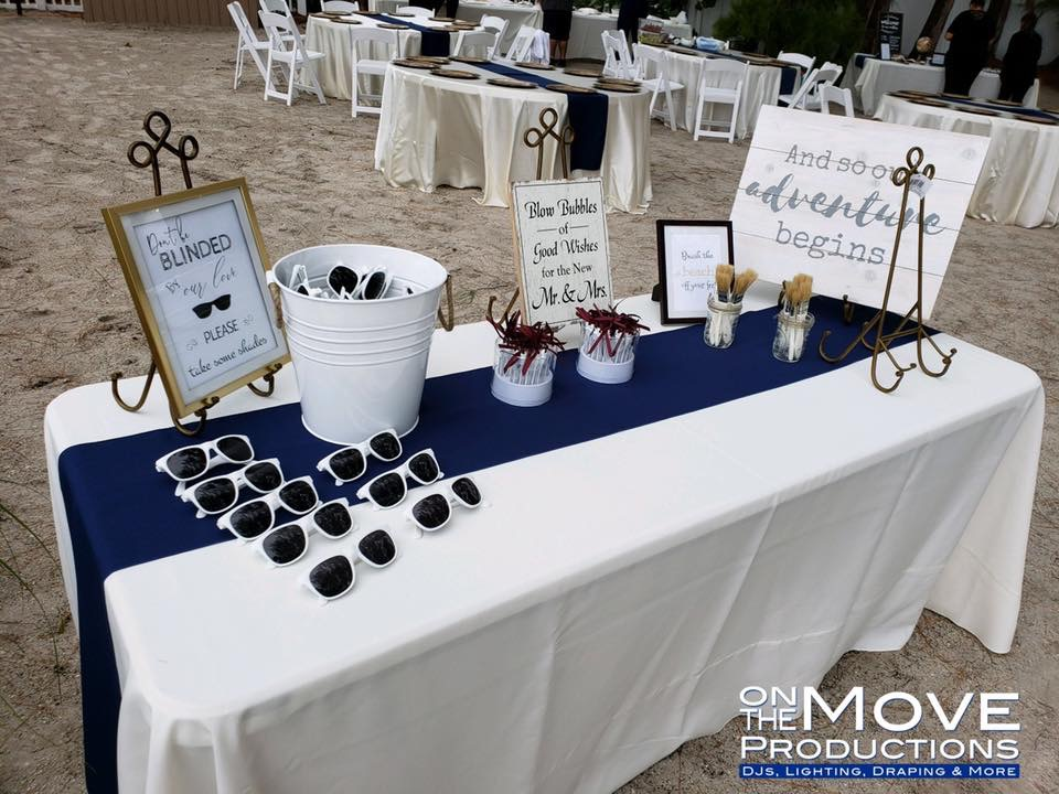 Ivory Majestic Tablecloths with Navy Poly Runners