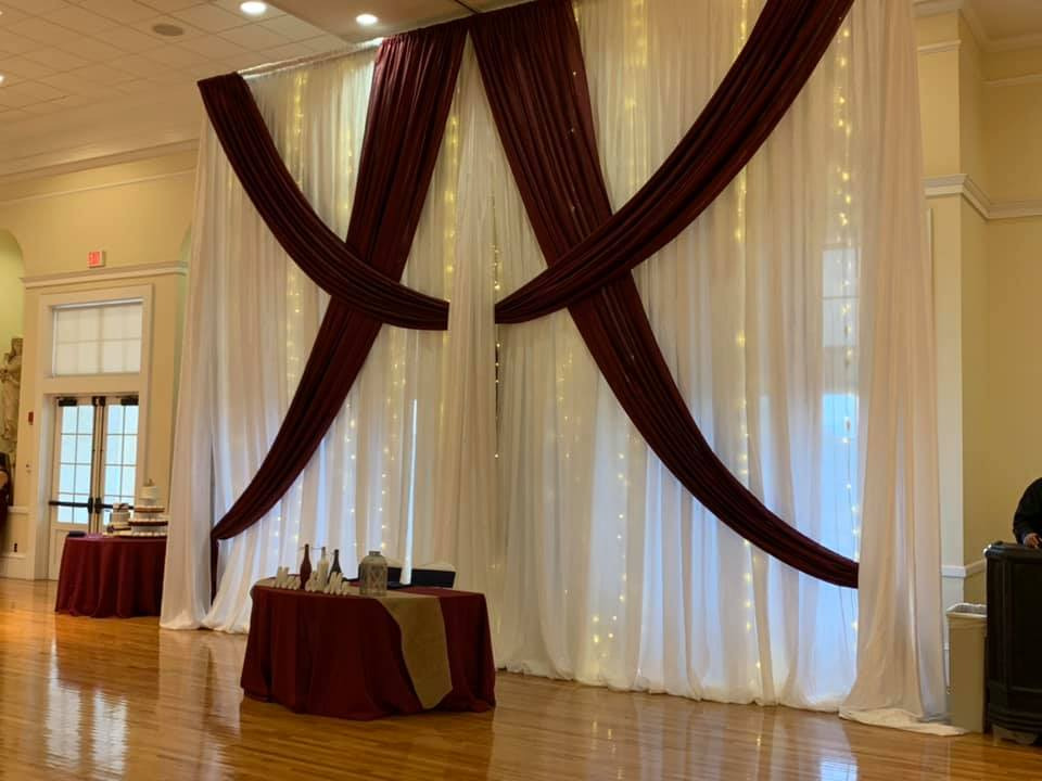 Burgundy Poly Tablecloth with Navy Poly Sashes and Burlap Runner