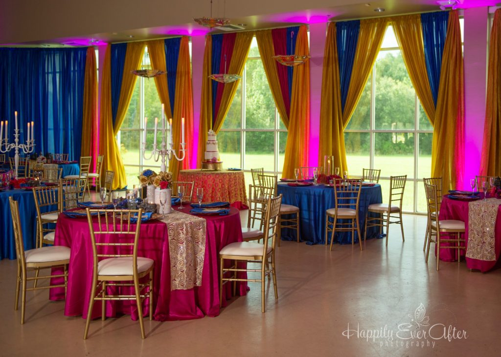 Fuchsia and Royal Blue Majestic Tablecloths and Napkins and Gold Ribbon Runners