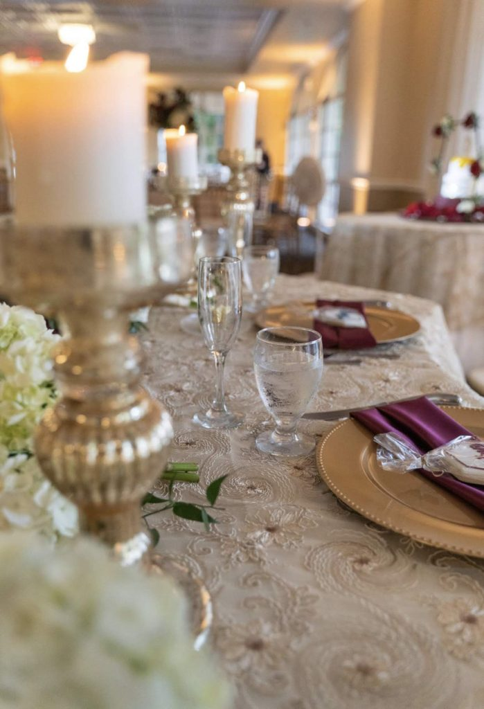 Champagne Jasmine Lace Overlay and Burgundy Satin Napkins and Gold Chargers
