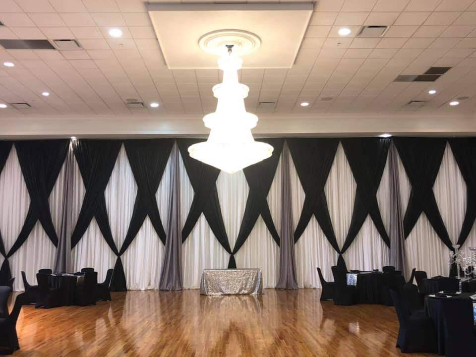 Black and White Stripe Runner w/ Black Majestic Sashes and Napkins w/ White Poly Chair Covers